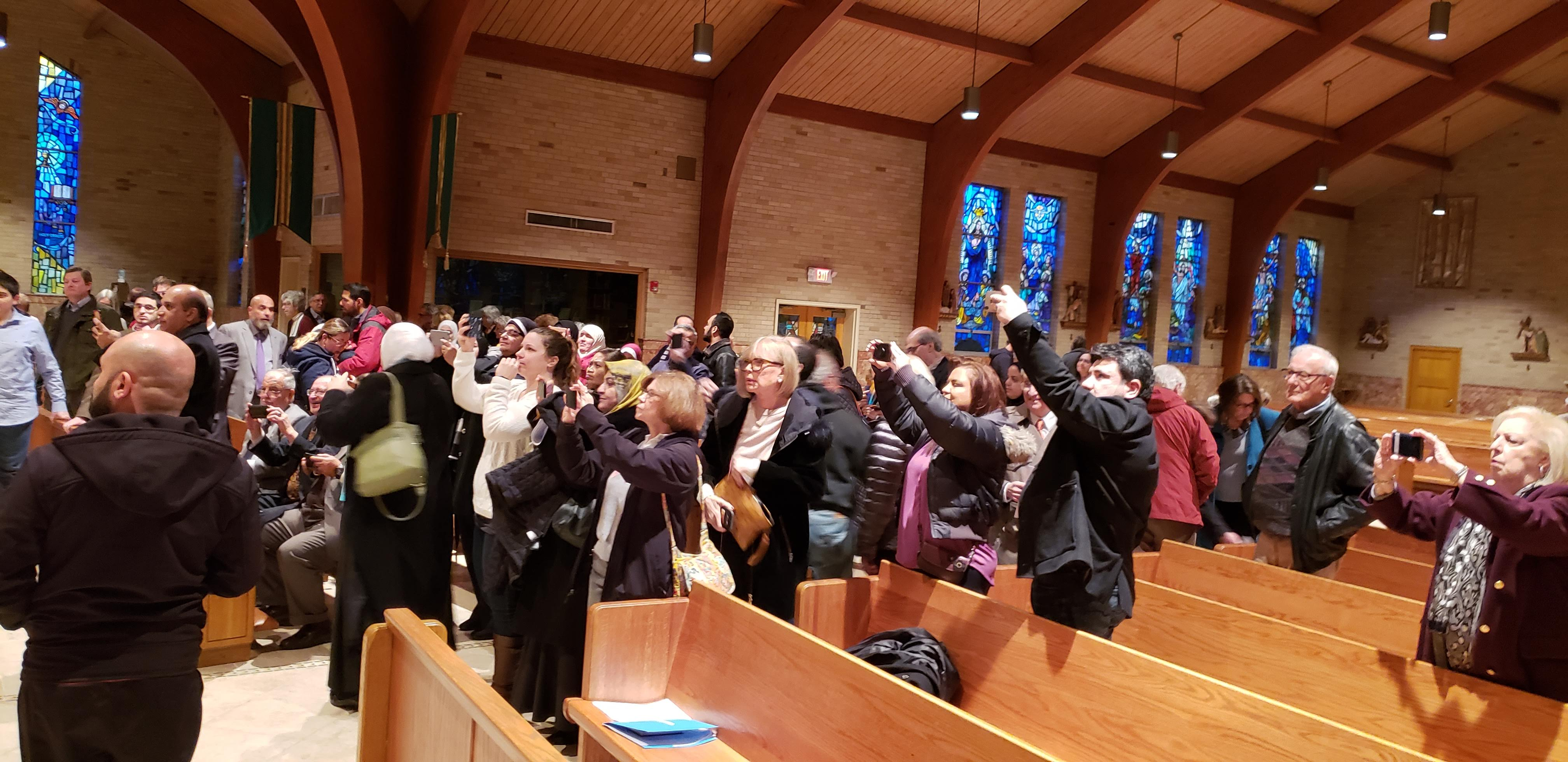 Participants Taking Photo of Leaders