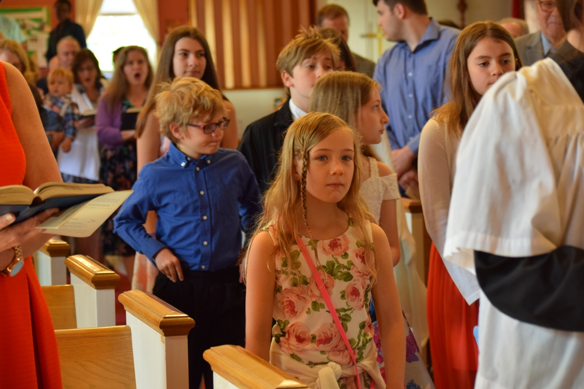 Sunday School Kids Followed by Choir